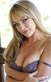 """You know what they say """"The older the wetter"""" and this MILF Shayla LaVeaux is dripping honey everywhere just looking at our huge cock. She grabs our giant slab of meat and sucks it a bit before stretching her hot pussy wide. Shayla groaned the whole time we fucked her hole and shooting ropes into her hungry mouth."""